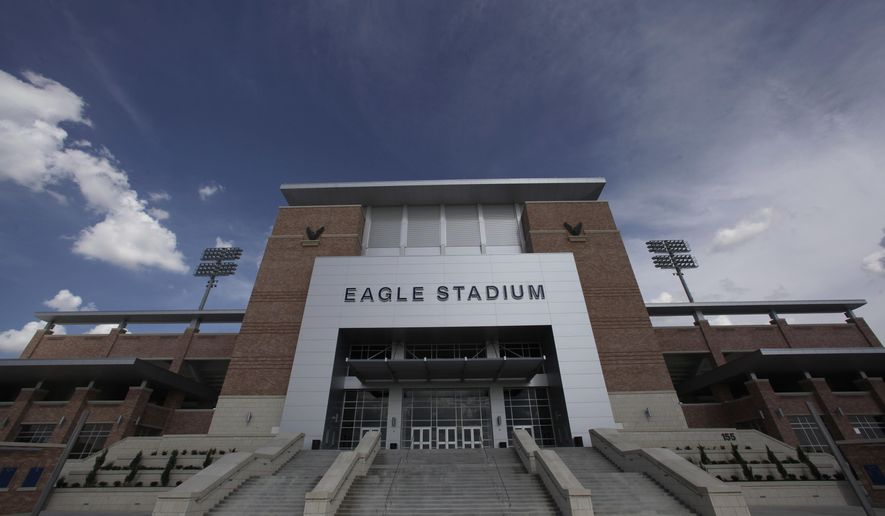 FILE - This Aug. 28, 2012 file photo shows the front entrance of Eagle Stadium at Allen High School in Allen, Texas. This suburban Dallas school district grabbed national attention in 2012 when it opened an eye-popping $60 million high school football stadium. Are such exorbitant price tags for high school stadiums the new normal? Only in Texas, it seems.  (AP Photo/LM Otero, File)