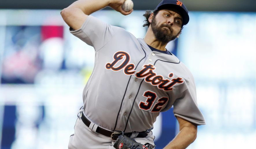 Detroit Tigers pitcher Michael Fulmer makes his major league debut as he faces the Minnesota Twins in the first inning of a baseball game Friday, April 29, 2016, in Minneapolis. (AP Photo/Jim Mone)