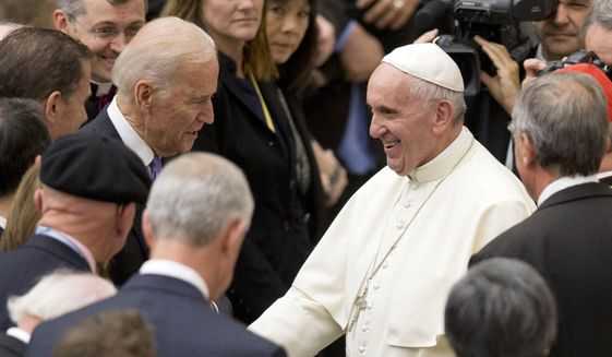 Pope Francis shakes hands with U.S. Vice President Joe Biden as he takes part at a congress on the progress of regenerative medicine and its cultural impact, being held in the Pope Paul VI hall at the Vatican, Friday, April 29, 2016. (AP Photo/Andrew Medichini)  ** FILE **
