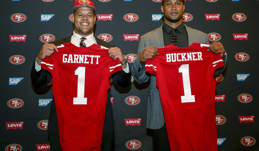 San Francisco 49ers first-round draft picks Joshua Garnett, left, a guard from Stanford, and DeForest Buckner, right, a defensive lineman from Oregon, pose for photos during the NFL football team's news conference in Santa Clara, Calif., Friday, April 29, 2016. (AP Photo/Tony Avelar) ** FILE **