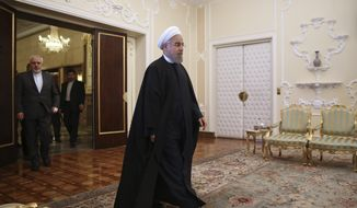 In this April 17, 2016, file photo, Iranian President Hassan Rouhani arrives for a meeting with Indian Foreign Minister Sushma Swaraj at the presidency office in Tehran, Iran. (AP Photo/Vahid Salemi, File)