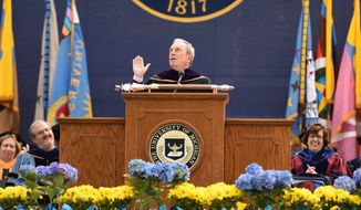 Former New York City Mayor Michael Bloomberg gives the commencement address at the University of Michigan's Class of 2016 graduation inside Michigan Stadium on Saturday, April 30, 2016. (Tanya Moutzalias /The Ann Arbor News - MLive.com Detroit via AP) LOCAL TELEVISION OUT; LOCAL INTERNET OUT; MANDATORY CREDIT