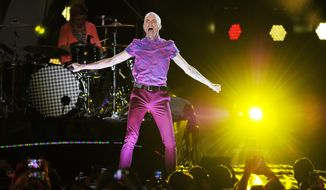 In this June 28, 2014, file photo, Neon Trees frontman Tyler Glenn performs at the iHeartRadio Ultimate Pool Party at Fontainebleau's BleauLive at Fontainebleau Miami Beach in Miami Beach, Fla. Two years after coming out as gay and praising the Mormon church for offering support, Glenn is denouncing his faith in his latest music video. (Photo Jeff Daly/Invision/AP, File)