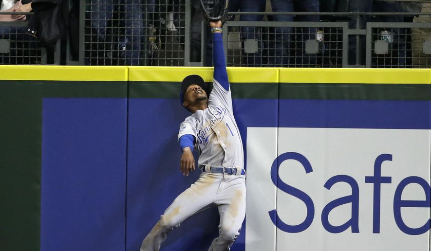 Kansas City Royals right fielder Jarrod Dyson leaps, but can't catch a solo home run by Seattle Mariners' Seth Smith during the sixth inning of a baseball game, Friday, April 29, 2016, in Seattle. (AP Photo/Ted S. Warren)