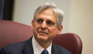 Conservative groups are set to launch ads in key states against Judge Merrick Garland, President Obama's choice to replace the late Justice Antonin Scalia on the Supreme Court. (Associated Press)