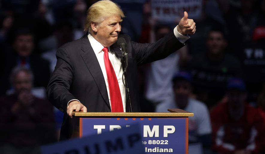 """FILE - In this April 27, 2016  file photo, Republican presidential candidate Donald Trump gestures during a campaign stop in Indianapolis. Trump has a Plan B on campaign money, and it involves the sort of outside groups that he has called """"corrupt."""" While the political newcomer might lock up the Republican presidential nomination in the next six weeks of voting, he and his allies are simultaneously mounting a public pressure campaign in case he falls short and finds himself at a contested convention this summer in Cleveland. (AP Photo/Darron Cummings, File)"""