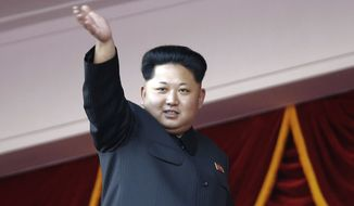 FILE - In this Saturday, Oct. 10, 2015 file photo,  North Korean leader Kim Jong Un waves at a parade in Pyongyang, North Korea. North Korea is preparing to hold a once-in-a-generation congress of its ruling party that is intended to rally the nation behind leader Kim Jong Un and could provide an important glimpse into Kim's plans for the country's economy and military. The congress is set to begin May 6, 2016. (AP Photo/Wong Maye-E, File)