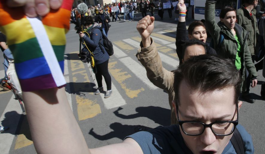 Gay rights activists march during a rally to mark May Day in St.Petersburg, Russia, Sunday, May 1, 2016. (AP Photo/Dmitri Lovetsky)