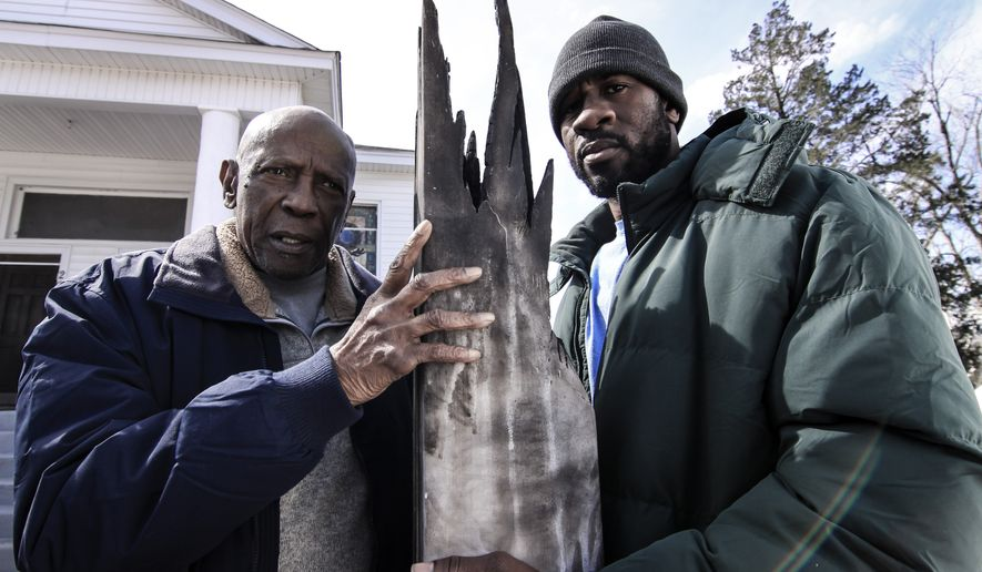 "Louis Gossett Jr. (left) and Michael Montgomery are seen inspecting the damage after a lightning strikes a cross in front of their small church in a scene from the faith-based drama ""The Reason.""  (Willie Kimbrough, The Reason Movie, LLC)"