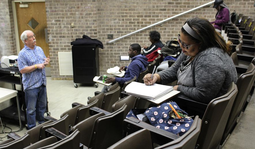 In this April 12, 2016 photo, Robert Bionaz, an associate professor of history at Chicago State University, lectures during a class at the university in Chicago. The school has a troubled history and has been hard hit by the state budget crisis, but students and experts say it remains a last shot for many to get a degree. (AP Photo/David Mercer)