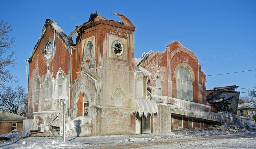 ADVANCE FOR RELEASE SUNDAY, MAY 1, 2016, AT 12:01 A.M. CDT. AND THEREAFTER - In this Jan. 6, 2014 photo, covered in ice and with hot spots still smoldering, the shell of the United Methodist Church remains in Syracuse, Neb. While the old structure is gone, the congregation remains and with it a seed ready to be planted in that dirt to grow a new building they envision as a vibrant community center, meeting space, child care center and place of worship. (Kristin Streff/The Journal-Star via AP) LOCAL TELEVISION OUT; KOLN-TV OUT; KGIN-TV OUT; KLKN-TV OUT; MANDATORY CREDIT