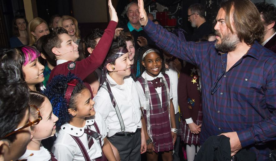 """Actor Jack Black, right, meets backstage with cast members of Broadway's """"School of Rock"""" after watching a performance at the Winter Garden Theatre on Sunday, May, 1, 2016, in New York. (Photo by Charles Sykes/Invision/AP)"""