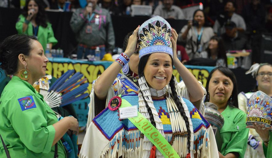 Danielle Ta'Sheena Finn is crowned Miss Indian World on Saturday, April 30, 2016 at the 33rd annual Gathering of Nations in Albuquerque, N.M. Finn, of Porcupine, North Dakota, and a member of the Standing Rock Sioux tribe, was chosen from among 24 Native American women from different tribes and traditions. The pageant closed three days of festivities at what's considered North America's largest powwow. (James Korenchen/Gathering of Nations via AP)