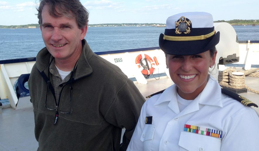 "FILE-In this June 13, 2015, file photo, Michael Hurley, a South Carolina author who lost his storm-battered sailboat on a failed Atlantic crossing, left, poses for a photo with Maine Maritime Academy junior Gabrielle Wells on the stern of the training vessel State of Maine, in Portland, Maine. Hurley used some experiences from his rescue last summer by a Maine Maritime Academy training ship for his new book, ""The Passage."" The book goes on sale June 1. (AP Photo/David Sharp, File)"