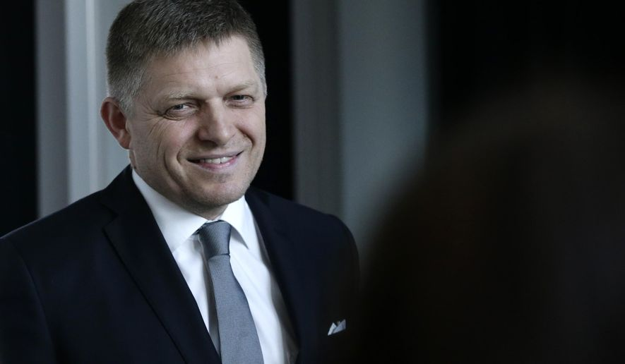 FILE - In this Sunday, March 6, 2016 file photo, Robert Fico chairman of the SMER-Social Democracy smiles after a TV debate after Slovakia's early general elections in Bratislava, Slovakia.  Slovakia's prime minister has been discharged from a clinic in the capital following heart surgery. The 51-year-old Robert Fico was hospitalized April 14 following a cardiac examination at the National Institute of Cardiovascular Diseases and was operated on April 22. (AP Photo/Petr David Josek, File)