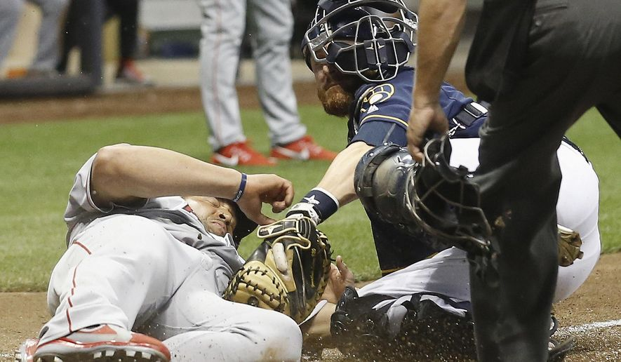 Los Angeles Angels' Albert Pujols slides safely under the tag of Milwaukee Brewers catcher Jonathan Lucroy during the eighth inning of a baseball game Monday, May 2, 2016, in Milwaukee. Pujols scored from second on a hit by C.J. Cron. (AP Photo/Morry Gash)
