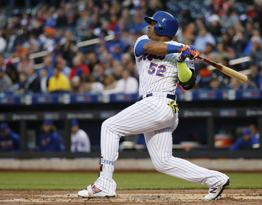 New York Mets Yoenis Cespedes watches his first-inning, two-run, home run in a baseball game against the Atlanta Braves, Monday, May 2, 2016, in New York. (AP Photo/Kathy Willens)