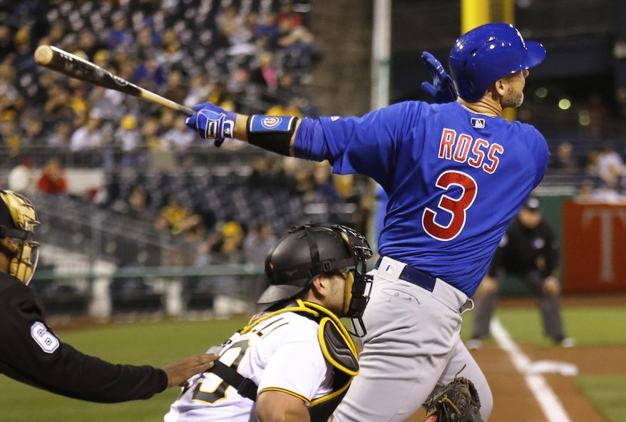 Chicago Cubs' David Ross (3) drives in two runs with a hit against the Pittsburgh Pirates in the fifth inning of a baseball game, Monday, May 2, 2016, in Pittsburgh. (AP Photo/Keith Srakocic)