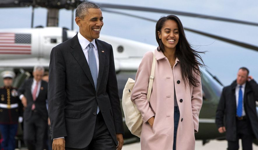 FILE - In a Thursday, April 7, 2016 file photo, President Barack Obama jokes with his daughter Malia Obama as they walk to board Air Force One from the Marine One helicopter, as they leave Chicago en route to Los Angeles.  The White House announced Sunday, May 1, 2016, that Malia Obama will take a year off after high school and attend Harvard University in 2017.(AP Photo/Jacquelyn Martin, File)