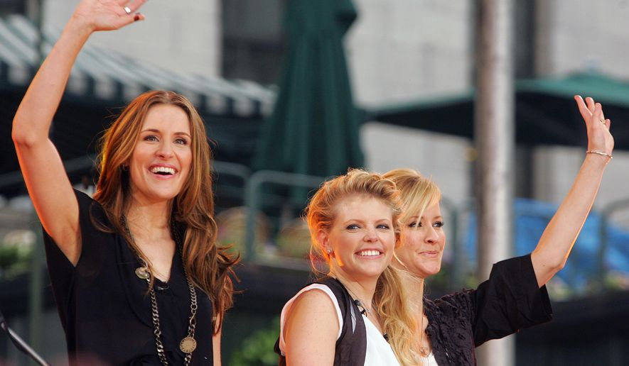 "In this May 26, 2006, file photo, Dixie Chicks, from left, Emily Robison, Natalie Maines and Martie Maguire, wave to the crowd as they perform on ABC's ""Good Morning America"" summer concert series in Bryant Park, in New York. The Dixie Chicks are adding more concerts to their U.S. tour that starts this summer 2016. (AP Photo/Dima Gavrysh, File)"