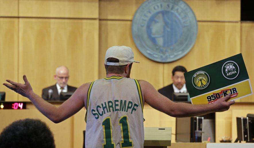 Andrew Wergeland-Rammage wears a vintage Seattle SuperSonics' jersey as he testifies before the Seattle City Council, including members Tim Burgess, left, and Bruce Harrell, Monday, May 2, 2016, in Seattle. The council was expected to vote on Monday on whether to vacate a stretch of road where an investor hopes to eventually build an arena that could house an NBA and NHL team. (AP Photo/Elaine Thompson)