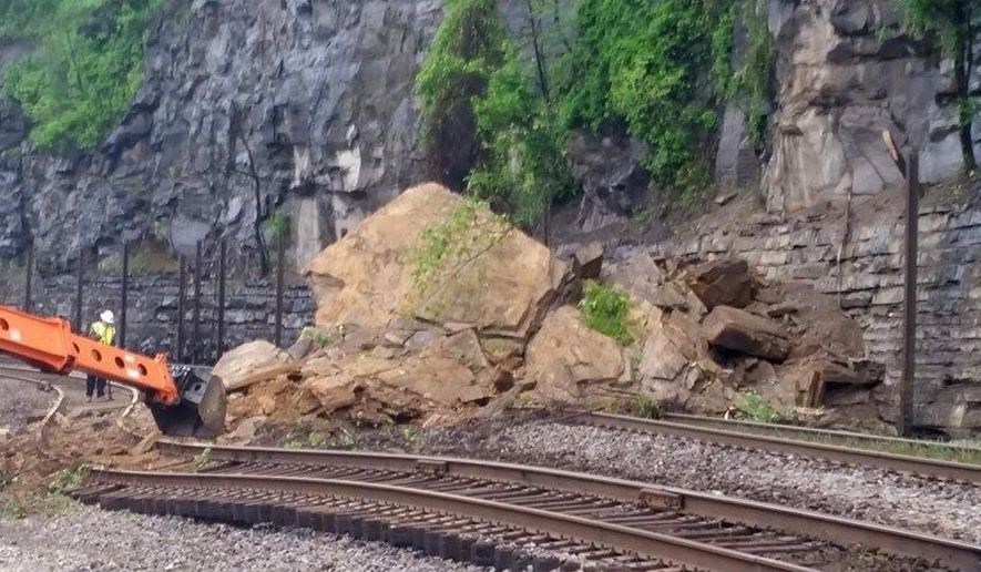 A Rock Slide Damaged Both The North And South Bound Railroad Tracks Of Norfolk Southern Near