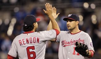 Washington Nationals Anthony Rendon (6) and Ryan Zimmerman (11) congratulate each other at the end of a baseball game against the Kansas City Royals at Kauffman Stadium in Kansas City, Mo., Monday, May 2, 2016. The Nationals beat the Royals 2-0. (AP Photo/Colin E. Braley)