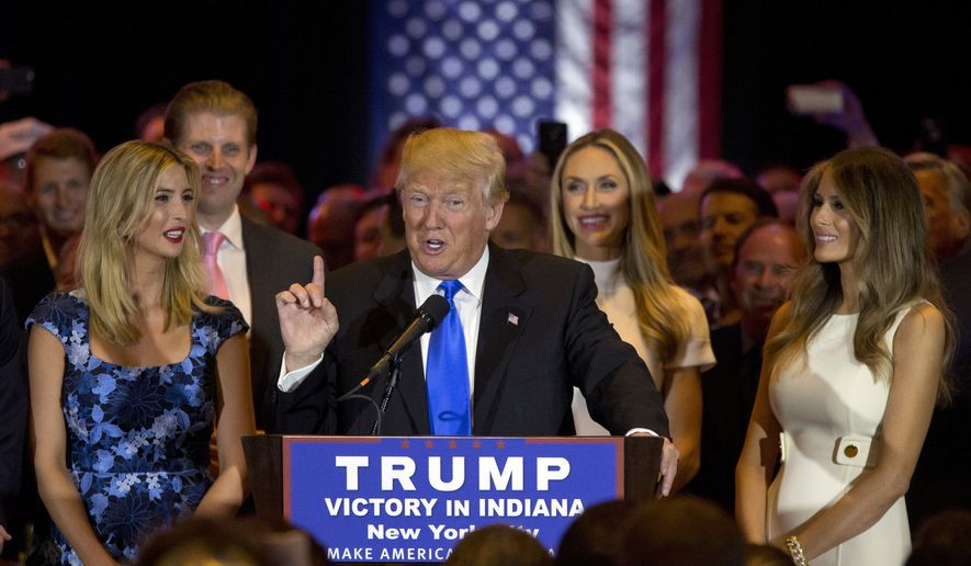 Republican presidential candidate Donald Trump is joined by his wife Melania, right, daughter Ivanka, left, and son Eric, background second from left, as he speaks during a primary night news conference, Tuesday, May 3, 2016, in New York. (AP Photo/Mary Altaffer)