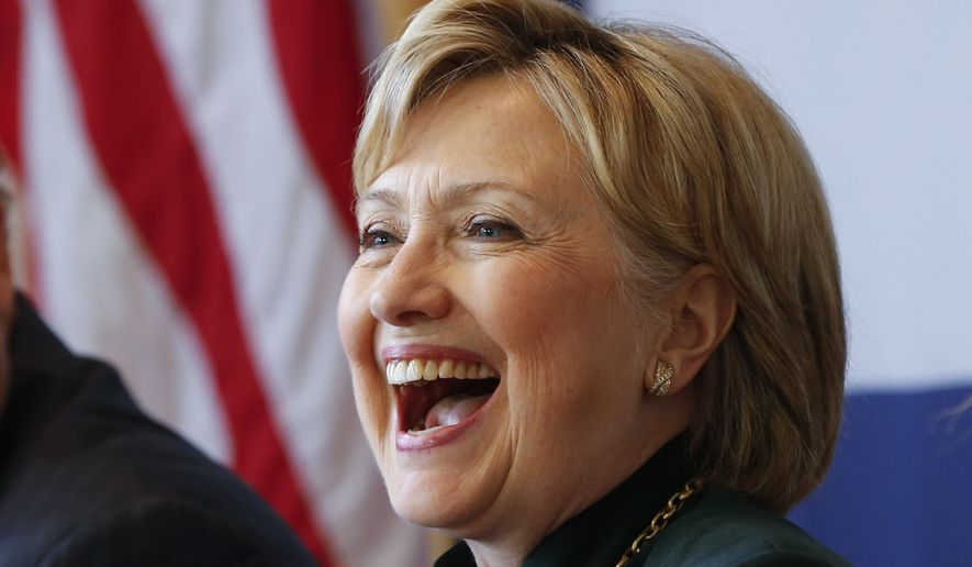 Democratic presidential candidate Hillary Clinton laughs during a campaign stop in Charleston, W.V., Tuesday, May 3, 2016. (AP Photo/Paul Sancya)
