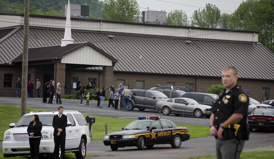 Mourners arrive at Dry Run Church of Christ for funeral services for six of the eight murder victims from Pike County, Tuesday, May 3, 2016, in West Portsmouth, Ohio.  Seven adults and a 16-year-old boy from the Rhoden family were found dead April 22 at four properties scattered across a few miles of countryside near Piketon, about 80 miles east of Cincinnati. (AP Photo/John Minchillo)