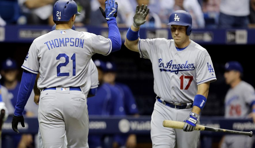 Los Angeles Dodgers' Trayce Thompson (21) high fives on-deck batter A.J. Ellis after his two-run home run off Tampa Bay Rays starting pitcher Matt Moore during the second inning of an interleague baseball game Tuesday, May 3, 2016, in St. Petersburg, Fla. (AP Photo/Chris O'Meara)