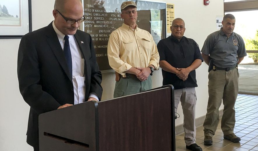Albuquerque FBI Public Affairs Specialist Frank Fisher, left, with local law enforcement agent holds a news conference regarding the death of the 11-year-old girl Ashlynne Mike, reportedly abducted on the Navajo Nation, in Shiprock, N.M., Tuesday, May 3, 2016. The air and ground search for the Navajo girl ended tragically Tuesday when authorities found the 11-year-old dead near the towering rock formation that gives the New Mexico town of Shiprock its name. (Jon Austria/The Daily Times via AP) MANDATORY CREDIT