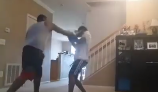 A Woodbridge, Virginia, man recorded himself boxing his 17-year-old son as punishment for skipping class, then shared the footage on Facebook, authorities said.