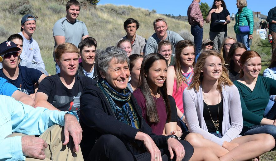 Interior Secretary Sally Jewell pose with students from Capital High of Helena at Hauser Lake, near Helena, Mont., on Tuesday, May 3, 2016. Jewell is using the scenic backdrop of Montana's Hauser Lake to urge Congress to permanently reauthorize a key funding source for the country's parks and recreation system. (AP Photo/Bobby Caina Calvan)