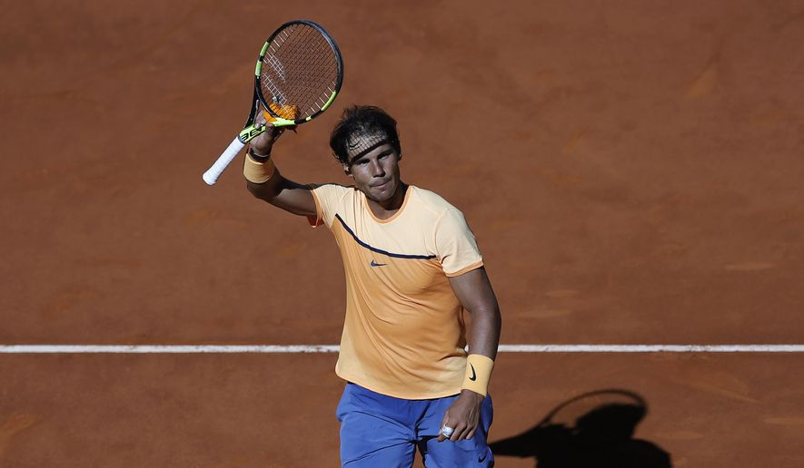 Rafael Nadal, from Spain, gestures to supporters at the end of his match against Andrey Kuznetsov, from Russia, during the Madrid Open tennis tournament in Madrid, Spain, Tuesday, May 3, 2016. Nadal won 6-3, 6-3. (AP Photo/Francisco Seco)