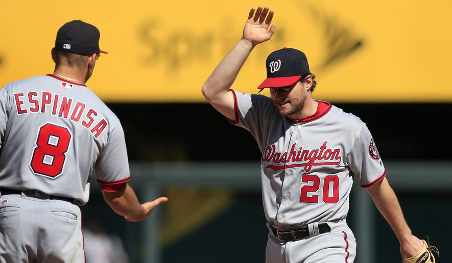 Washington Nationals shortstop Danny Espinosa (8) and second baseman Daniel Murphy (20) celebrate following a baseball game against the Kansas City Royals at Kauffman Stadium in Kansas City, Mo., Wednesday, May 4, 2016. The Nationals defeated the Royals 13-2. (AP Photo/Orlin Wagner)