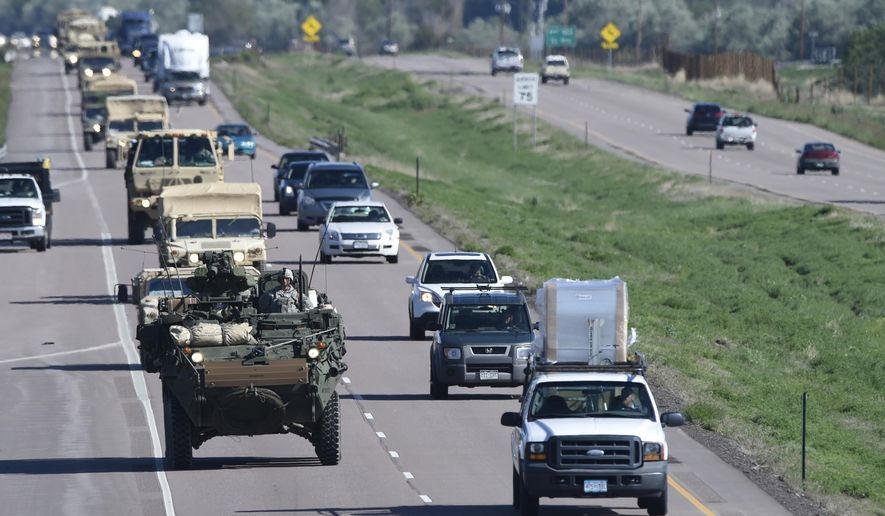 FILE - In this May 27, 2015 file photo, a Stryker armored vehicle leads a group of vehicles south on I-25 south in Colorado Springs, Colo. Investigators say an Army vehicle took the wrong road in the dark and was trying to make a U-turn when it tumbled 250 feet off a cliff at a Colorado training range in Feb. 2015, killing one soldier and injuring five. Investigators also said medical personnel had recommended that the soldier who died shouldn't go on the exercise because of an unspecified condition. But it wasn't clear if his condition was a factor in the 2015 crash of a Stryker fighting vehicle at Fort Carson. (Mark Reis/The Gazette via AP, File) MAGS OUT; MANDATORY CREDIT