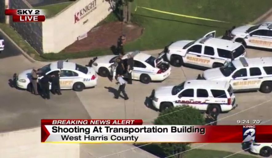 Officers respond to reports of a deadly shooting at the Knight Transportation office in Katy, Texas, Wednesday, May 4, 2016. Authorities said a recently fired employee opened fire at the transportation company. (KPRC Houston via AP) MANDATORY CREDIT