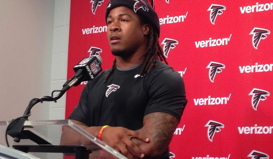 Atlanta Falcons NFL player Devonta Freeman speaks during a news conference, Wednesday, May 4, 2016, in Flowery Branch, Ga. Freeman said Wednesday he was walking in his neighborhood when he saw an elderly woman cutting her grass. After he stopped to offer his assistance, including an offer to cut her grass in the future, a family member took a photo _ and soon his good deed was on social media.  (AP Photo/Charles Odum)
