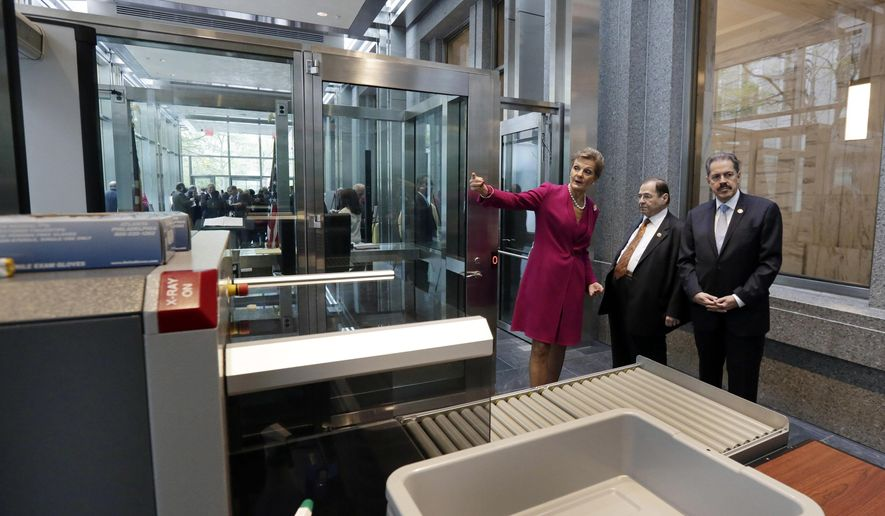 Chief Judge Loretta Preska, describes the new security pavilion at the Daniel Patrick Moynihan U.S. Courthouse, to U.S. Rep. Jerrold Nadler, center, and U.S. Rep. Jose Serrano after ribbon-cutting ceremonies, in New York, Wednesday, May 4, 2016. The new security pavilion was dedicated Wednesday at a federal courthouse where high-profile terrorism trials have taken place blocks from where the Sept. 11 attacks downed the 110-story twin towers of the World Trade Center. (AP Photo/Richard Drew) ** FILE **