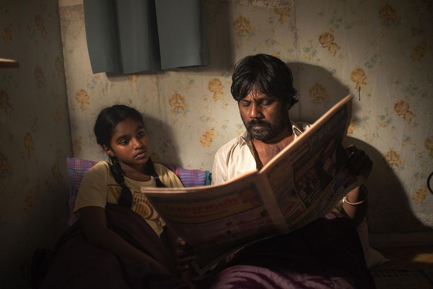 """This image released by Sundance Selects shows Claudine Vinasithamby, left, and Jesuthasan Antonythasan in a scene from """"Dheepan."""" (Paul Arnaud/Sundance Selects via AP)"""