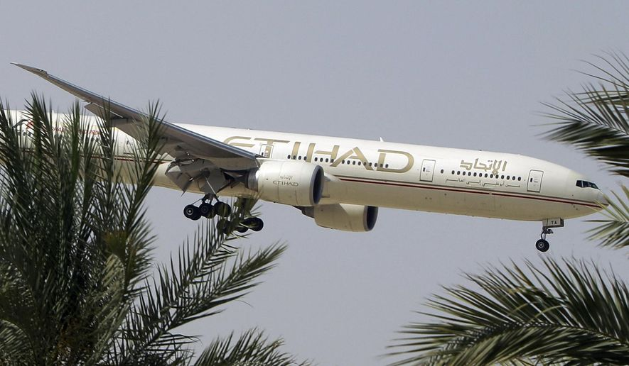 FILE- In this Sunday, May 4, 2014 file photo, an Etihad Airways plane prepares to land in Abu Dhabi Airport, United Arab Emirates. The United Arab Emirates' national airline says several passengers were injured when one of its flights encountered sudden turbulence as it prepared to land in the Indonesian capital, Jakarta. (AP Photo/Kamran Jebreili, File)