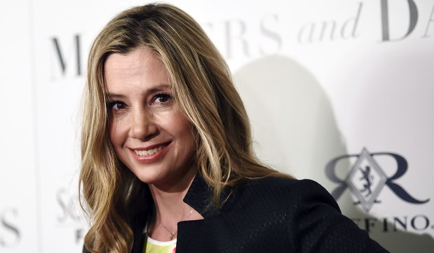 "Mira Sorvino, a cast member in ""Mothers and Daughters,"" poses at the premiere of the film at the London West Hollywood Hotel Screening Room on Thursday, April 28, 2016, in West Hollywood, Calif. (Photo by Chris Pizzello/Invision/AP)"