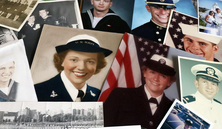 Wilma Norris, left, and her daughter Rosemary Agee, right, both served in the U.S. Navy. Military service as sailors is a part of the family tradition as evidenced by family photographs of sons, husbands and siblings that have all served or are currently serving in the U.S. Navy. (Michael Sullivan/The News-Review via AP)