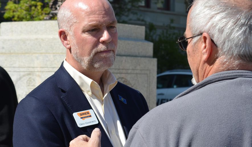 Greg Gianforte, left, a Republican running for Montana governor, chats with a member of the crowd after a news conference held by the Bozeman Republican at the state Capitol in Helena Wednesday, May 4, 2016. Gianforte says the state needs new leadership to steward Montana's infrastructure needs. (AP Photo/Bobby Caina Calvan)