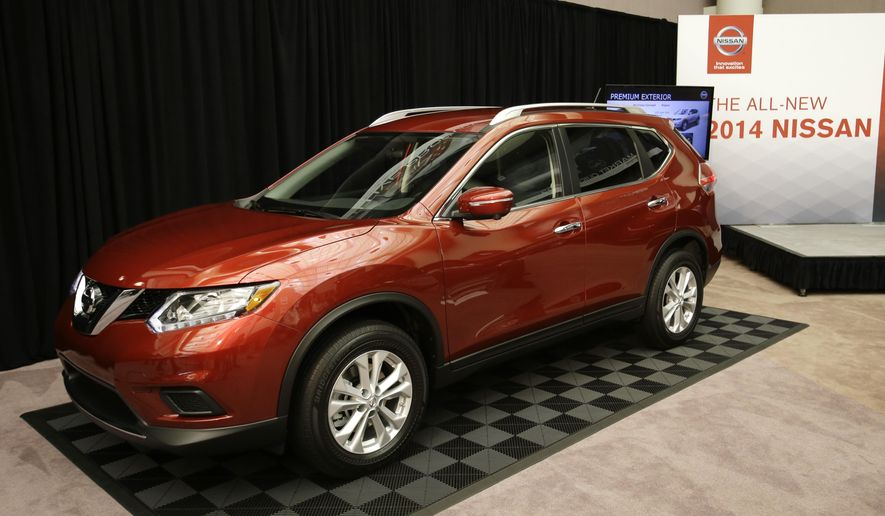 FILE - In this Tuesday, Sept. 10, 2013, file photo, the Nissan 2014 Rogue is unveiled in Farmington Hills, Mich. Nissan is recalling more than 108,000 Rogue small SUVs in the U.S. because the rear hatch door could fall on people without warning.The recall covers Rogues from the 2014 to 2016 model years. The company says in government documents that salt water can get into the rear lift gate supports and cause rust. The supports can lose gas pressure and break, increasing the risk of injury. (AP Photo/Carlos Osorio, File)