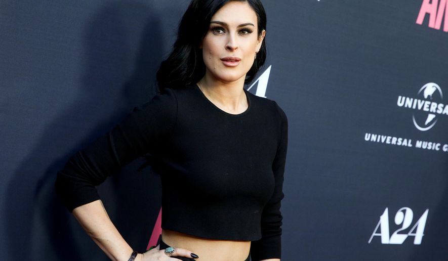 """FILE - In this June 25, 2015, file photo, Rumer Willis arrives at the LA Premiere of the documentary """"Amy"""" in Los Angeles. Willis posted a photo to her Instagram account on May 3, 2016, that she says was Photoshopped to make her jaw look smaller. (Photo by Rich Fury/Invision/AP, File)"""
