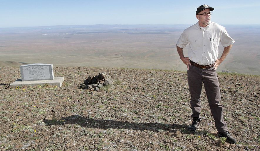Charles Stenvall, mid-Columbia River NWR Complex project leader for the U.S. Fish and Wildlife Service, stands at the summit of Rattlesnake Mountain Tuesday, May 3, 2016, during a tour of the Hanford Reach National Monument area. The area was claimed by the federal government in 1943 as part of the security zone around the Hanford nuclear reservation and few people have been allowed on the land since then. Now federal officials say they are working to resume tours. (Bob Brawdy/The Tri-City Herald via AP) LOCAL TELEVISION OUT; LOCAL RADIO OUT KONA