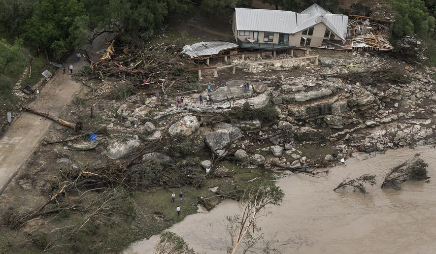 FILE - In this file aerial photo taken on May 24, 2015, a home that was taken off its foundation sits along the Blanco River after rain caused flash flooding in Wimberley, Texas. Experts have called for better public emergency notifications since deadly storms and flooding last year in Central Texas. Hays County and San Marcos officials on May 3, 2016, released the recommendations following disastrous weather during Memorial Day weekend and last October. Some suggestions have already been implemented. (Rodolfo Gonzalez/Austin American-Statesman via AP, File) AUSTIN CHRONICLE OUT, COMMUNITY IMPACT OUT, INTERNET AND TV MUST CREDIT PHOTOGRAPHER AND STATESMAN.COM, MAGS OUT