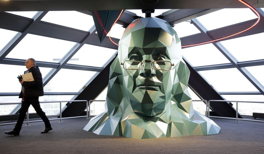 FILE - In this Nov. 24, 2015 file photo, a person walks past a sculpture of Benjamin Franklin at the One Liberty Observation Deck in Philadelphia. The City of Brotherly Love will get a lot of attention later this summer during the Democratic National Convention, with attractions ranging from American history classics to new parks and outdoor venues. (AP Photo/Matt Rourke, File)